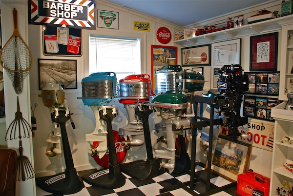 "Dan Graf's Newburyport, Massachusetts, garage, which he calls ""The Museum,"" contains his collection of full-size outboard motors. (Via ""Mantiques""; courtesy of Lindsey Bateman, ""Hunting & Fishing Collectibles"" magazine.)"