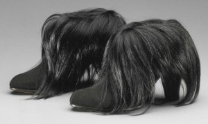 Schiaparelli topped these suede boots with monkey fur in 1938. Courtesy the Philadelphia Museum of Art.