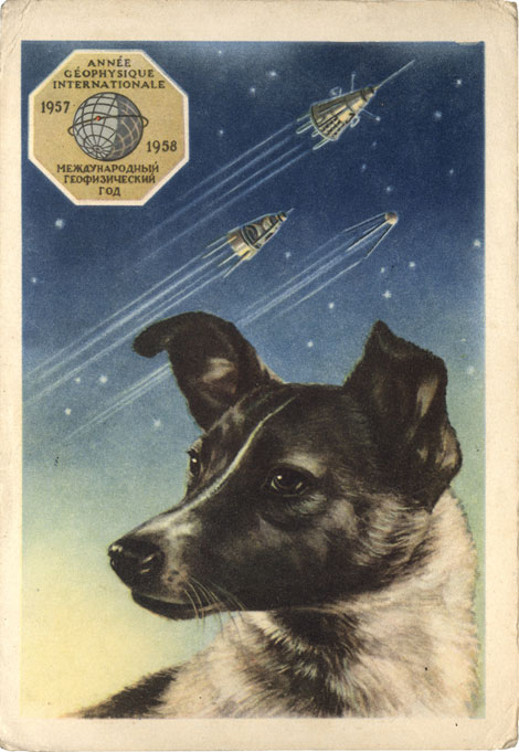 "A portrait of Laika by the artist E. Gundobin, with the first three Sputniks in the background. Text of this 1958 postcard from the USSR reads ""International Geophysical Year 1957–1958."" (© FUEL Publishing)"