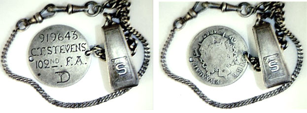 "This watch chain is attached to a love-token dog tag on an 1867 French 2 Franc. It reads, ""919643, C.T. Stevens, 102nd F.A., D,"" and F.A. stands for ""Field Artillery."" (Courtesy of the Love Token Society)"
