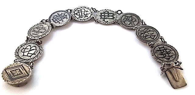 This love-token bracelet belonged to Stephanie Bougere, the widow of plantation owner Achille D. Bougere, and it features her initials, as well as those of her seven children, Horace P., Fannie A., Clarence L., Pauline, Albert R., Achille E., and Blanche D. The coins were enameled in black in mourning of her husband. (Courtesy of the Love Token Society)