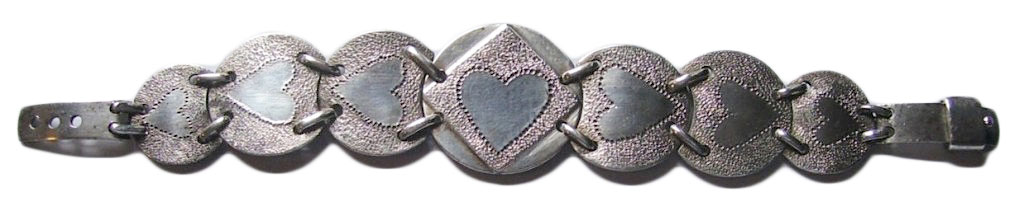 During WWII, U.S. soldiers in the Pacific Theater were paid in Australian coins, some of which they would turn into romantic jewelry, like this bracelet. (Courtesy of the Love Token Society)
