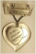 "This WWII Lucite-and-love-token pendant says ""New Guinea"" and ""To My Darling Sweetheart 1945."" (Courtesy of the Love Token Society)"