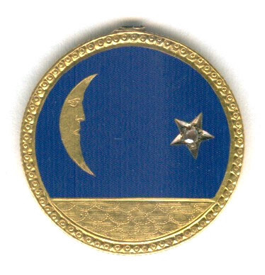 This Victorian love token on a 10-dollar gold coin features a moon and star design with blue enamel and a jewel. (Courtesy of the Love Token Society)