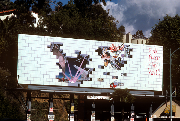 In 1980, the white bricks of this Pink Floyd billboard were slowly removed over a period of weeks to reveal the imagery underneath. Photo by Robert Landau.