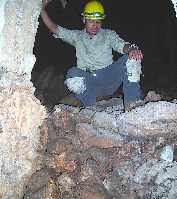 "A student from Cal State L.A. crouches on a man-made retaining wall built inside the Midnight Terror Cave. Image via <a href=""http://web.calstatela.edu/academic/anthro/MidnightTerror.htm"">Cal State L.A.</a>"