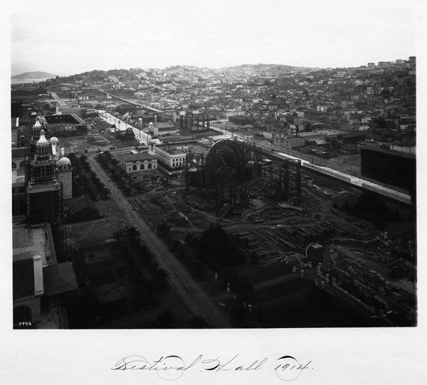 The PPIE's Festival Hall under construction in 1914 with the city behind it. Courtesy the Seligman Family Foundation.