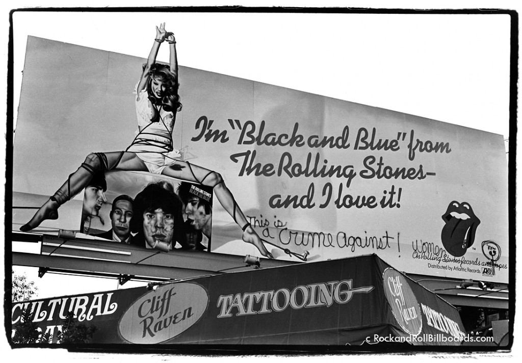 """Some billboards created controversy, like this 1976 ad for """"Black and Blue,"""" which Landau captured complete with outraged graffiti about violence against women. Photo by Robert Landau."""