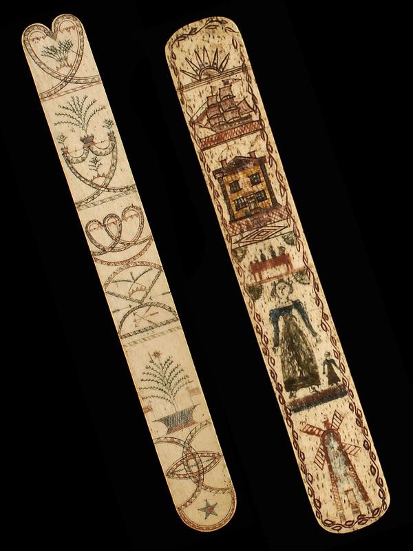 """Two """"whalebone"""" scrimshaw busks. At left, a 10.25-inch example from the mid-19th century features a heart, shield with plants, geometric forms with foliate designs and arrows, potted tree with American flags, and five-pointed star at the bottom. At right, an 11-inch 1840 busk carved by a sailor includes a sunrise, ship, house, table with beverages, mother with child, and windmill. (Both via <a href=""""http://www.eldreds.com/"""">Eldred's Auctions</a>)"""
