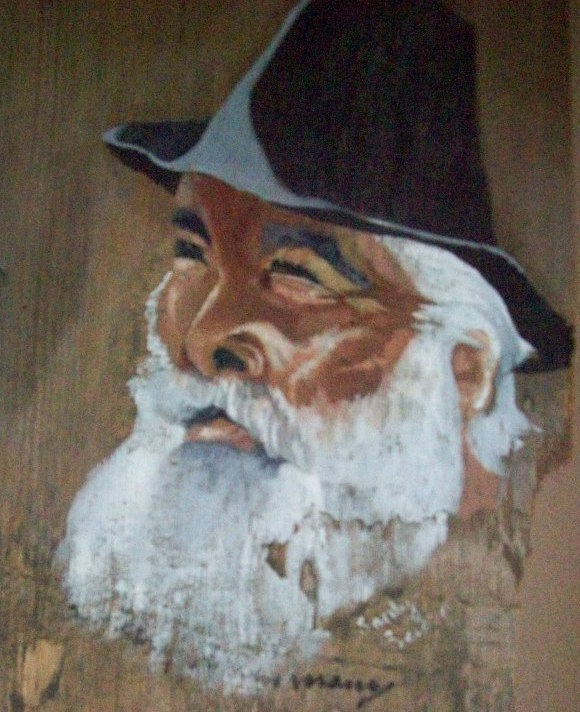 """A driftwood painting of the famous late hobo Maurice """"Steam Train Maury"""" Graham in the Hobo Museum. (Via the Hobo Museum's Facebook page)"""