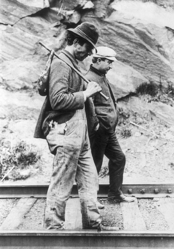 Two hoboes walk along railroad tracks, after being put off a train, circa 1907-1912. (Via Library of Congress)