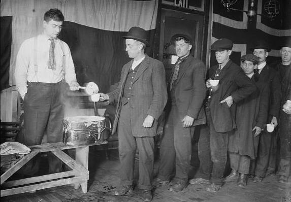 Hoboes line up for a breakfast of coffee at the New York City Hotel de Gink. (From the Bain News Service, Library of Congress)