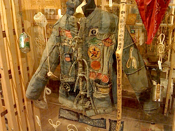 The collection at the Hobo Museum includes hobo clothing, walking sticks, knots, and cups made out of cans. (Via the Hobo Museum)