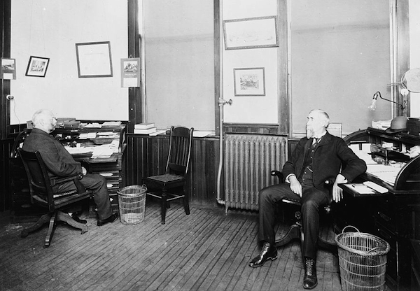 "Henry Leland (right) and Robert Faulconer (left) of Leland & Faulconer, which became Cadillac, circa 1903, each with his own empty wicker waste basket. Photo via the <a href=""http://www.loc.gov/item/det1994022729/PP/"">Library of Congress</a>."