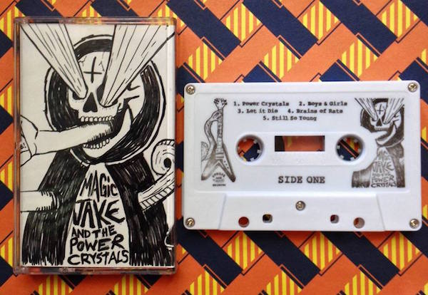 Top: A fraction of Don Campau's home-tape collection,  including cassettes by Eric Muhs with Charles Laurel and by Dino DiMuro. (Courtesy of Don Campau) Above: Burger Records' cassette release of the eponymous 2012 album by the Detroit garage-rock supergroup Magic Jake and the Power Crystals. (Via the Burger Records Facebook page)