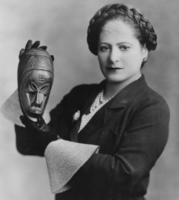 Helena Rubinstein holds one of her masks from the Ivory Coast in 1934. (Photo by George Maillard Kesslere, courtesy of the Jewish Museum, via the Helena Rubinstein Foundation Archives, Fashion Institute of Technology, SUNY, Gladys Marcus Library, Special Collections)