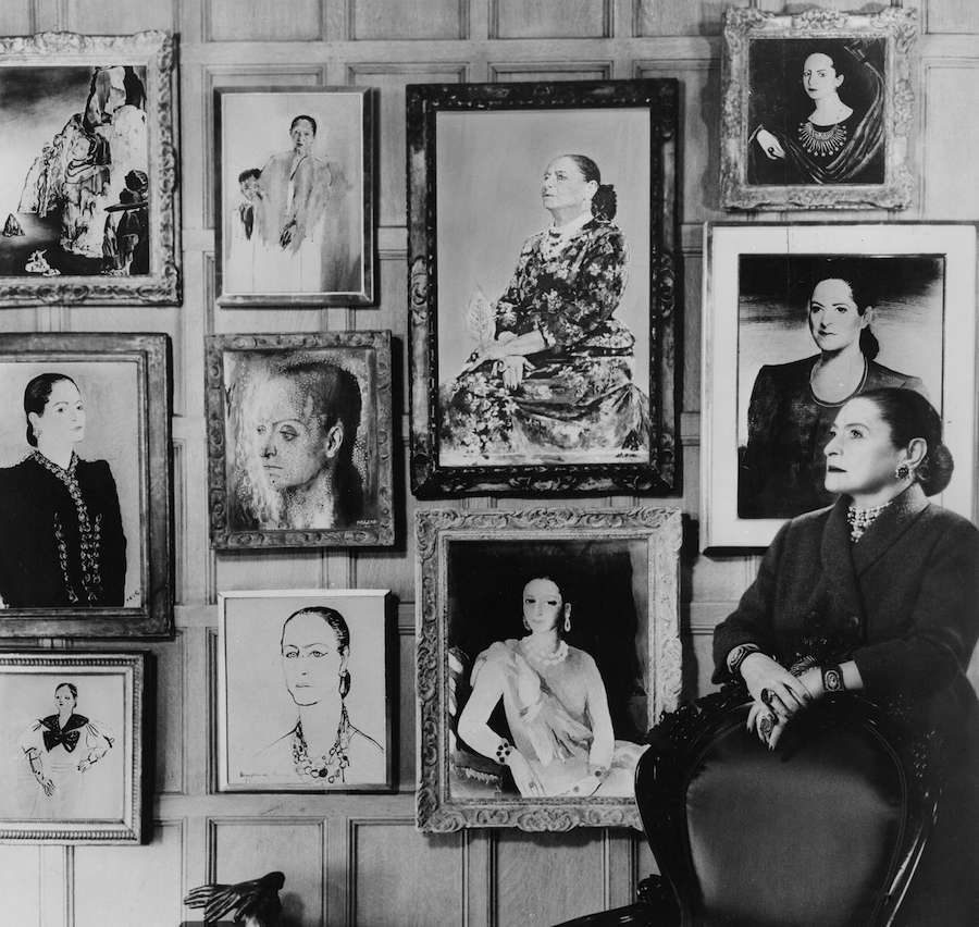 Helena Rubinstein in front of a montage of some of the many portraits she commissioned throughout her life. (From the Helena Rubinstein Foundation Archives, Fashion Institute of Technology, SUNY, Gladys Marcus Library, Special Collections)
