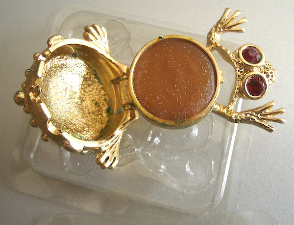 This Helena Rubinstein compact in the shape of a frog, circa 1960s-'70s, was meant to be carried in the purse so a woman could easily refresh her fragrance. (Via eBay)