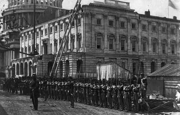 Union soldiers stand at attention in front of the U.S. Capitol on May 13, 1861. (Via Library of Congress)