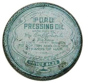 A tin of Annie Malone's Poro Pressing Oil, circa 1910s.