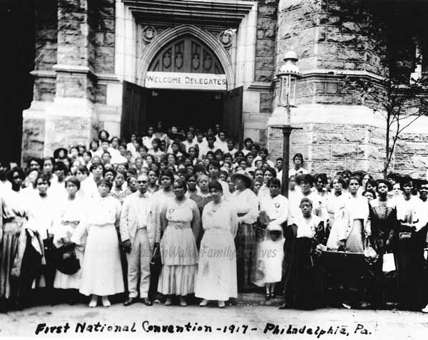 "Madam Walker, at center, poses with many sales agents at the first Madam C.J. Walker national convention in Philadelphia. Image ©<a href=""http://www.madamcjwalker.com/#&panel1-1"">Madam Walker Family Archives</a>."
