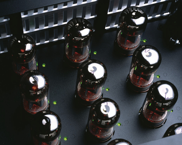 There are a dozen tubes inside a VTL Siegfried Reference Monoblock amplifier. The green lights indicate when the automatic bias is adjusting any individual tube, and also show which tube is bad in the event of a tube fault.