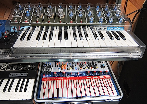 One of the gems of the Vintage Synthesizer Museum is a rare, clear, Gleeman Pentaphonic. Below that is a recent reissue of an Electric Music Box, often called a Music Easel, manufactured by Buchla. The Sequential Pro-One to the left is also fairly common.