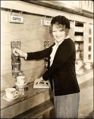 """Actress Clara Bow fills her cup at a Horn & Hardart in a promotional still for the 1931 film """"No Limit."""""""