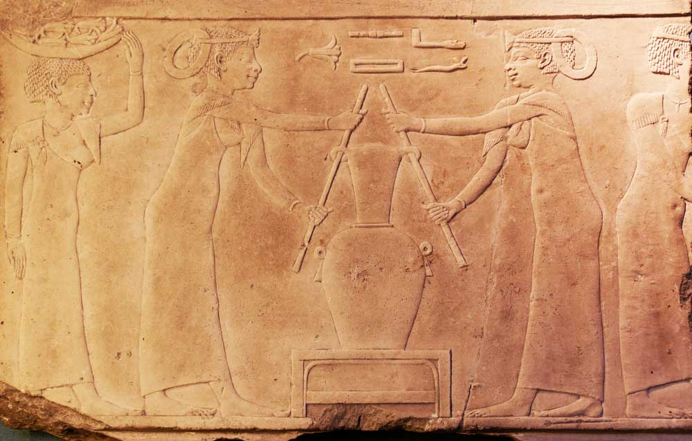 Top: A Mum deodorant advertisement from the 1920s captures the rise of the modern deodorized era. Above: This Egyptian relief carving in a tomb illustrates the making of lily perfume, circa 2500 B.C.