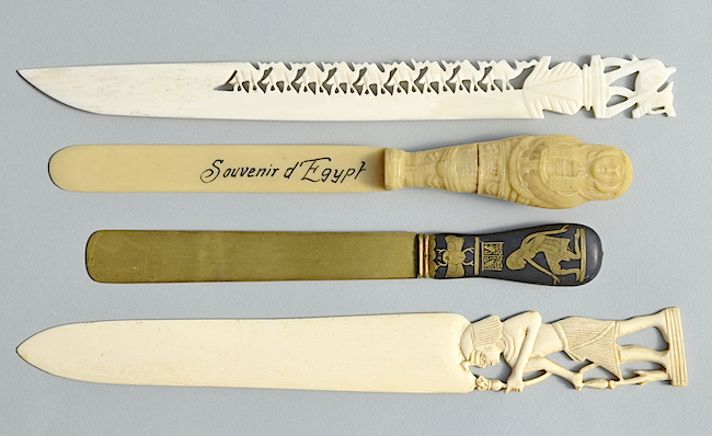Souvenir paper-knives from Egypt made (from top to bottom) of bone, plastic, brass, and ivory.