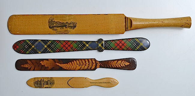 Mauchline ware paper-knives. From top: a cricket-bat design; tartan ware; fern ware; and a combination paper-knife and book marker.
