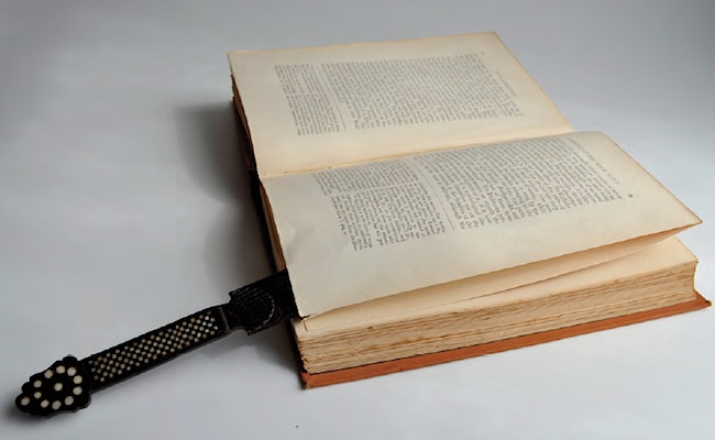 A paper-knife inserted between the uncut leaves of an 1882 book titled The History of Indian Literature. Each signature has 16 leaves requiring four cuts. The paper-knife is from Sri Lanka and is made from palm wood, with bone and horn decoration.
