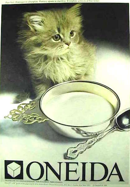 "This 1981 Oneida Limited ad shows a kitten who's been served milk in a porringer with a ""Fantasy""-pattern spoon."