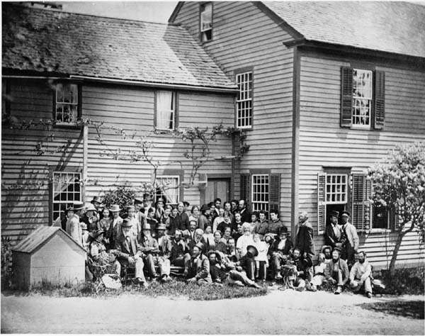 Members of the Wallingford, Connecticut, branch of the Oneida Community pose outside of their home in 1876. (From the Oneida Community Collection at Syracuse University Library in New York)