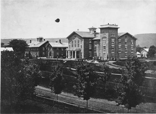 This photo from June 25, 1863, shows the newly completely Mansion House (right) next to the old (left). The expansion of the new Mansion House was completed by 1878. (Photo by O.A. Hollenbeck. From the Oneida Community Collection at Syracuse University Library in New York)