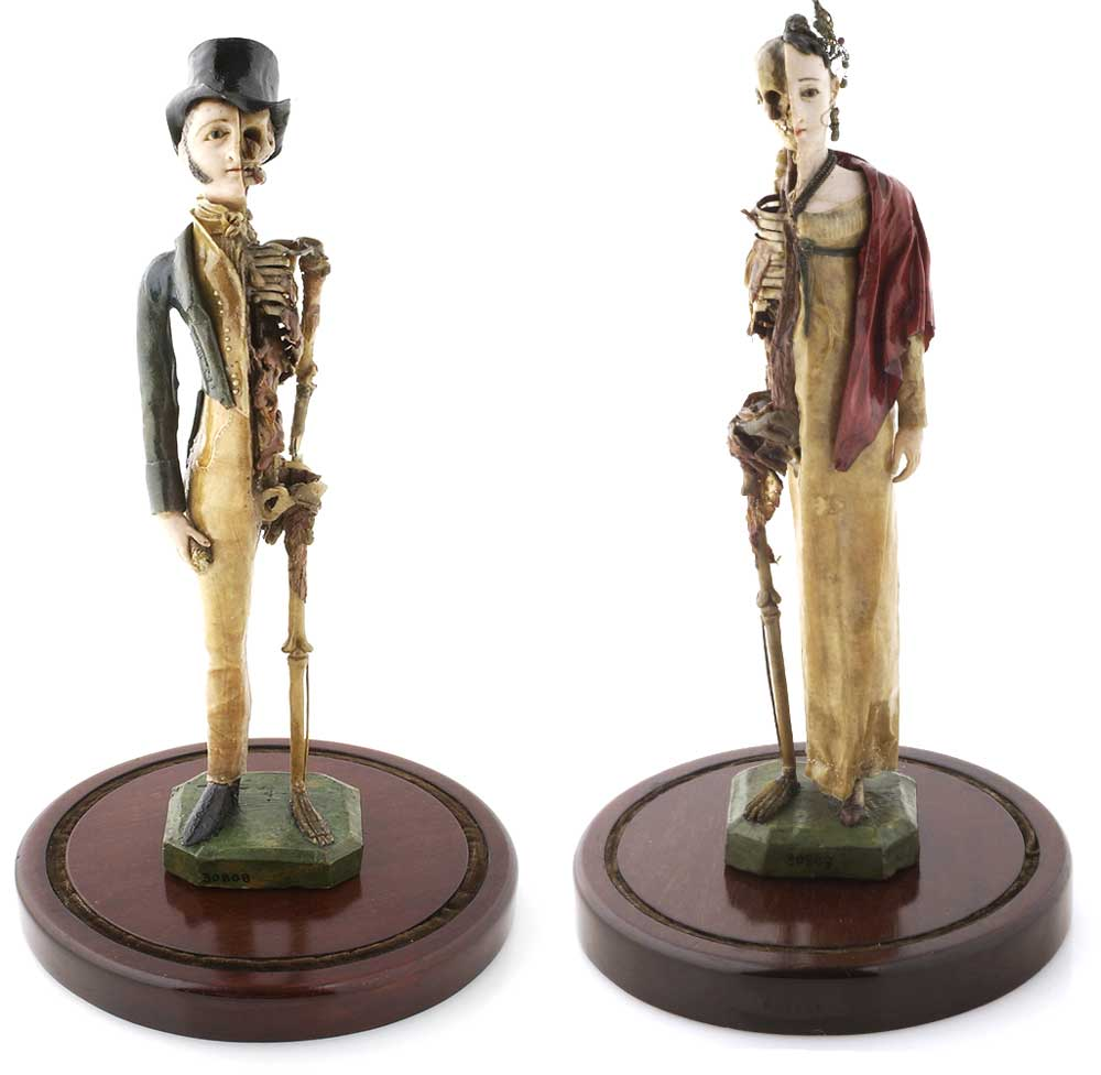 Two miniature wax models depicting a couple—each half fashionable youth, half skeleton—as a form of memento mori, circa early 19th century. Courtesy the Wellcome Library, London.