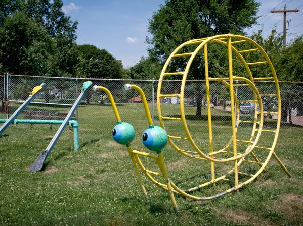 Top: A Space Age rocket-themed playground set by Miracle Playground Equipment, introduced circa 1968, photographed in Burlington, Colorado, in 2009. Above: Two seesaws and a snail-shaped climber, circa 1970s, photographed in Vandergrift, Pennsylvania, in 2007. (Photos by Brenda Biondo)