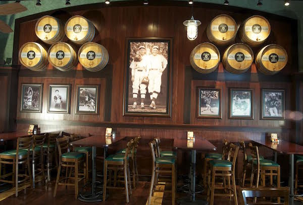 Hospitality Solutions designed the interior of Jake N Joes Sports Grille in Norwood, Massachusetts, using very select vintage photos of Boston sports teams. (Courtesy of Hospitality Solutions)