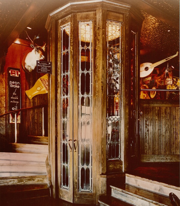 Behind the three-level phone booth in the San Bruno, California, Friday's—circa 1980—you see an explosion of antiques and memorabilia including vintage signs, taxidermy, and musical instruments. (Promotional photo, courtesy of Bob Treat)