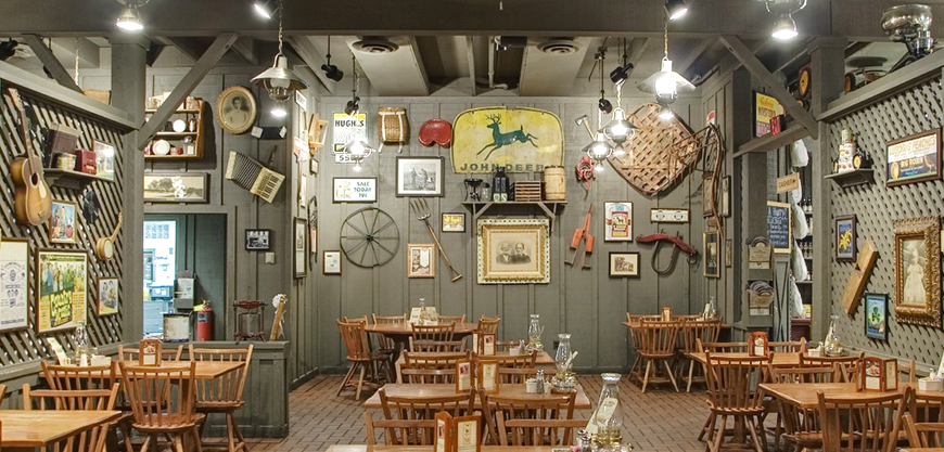 Real antiques adorn the dining room of a Cracker Barrel. Click on the image to see a larger version of it. (Via Cracker Barrel Old Country Store)