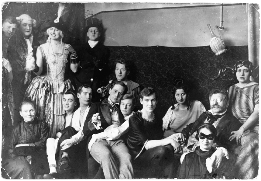 Dr. Magnus Hirschfeld (second from right, in glasses) with community members dressed for a costume party at the Institute for Sexual Science in Berlin, circa 1920s.
