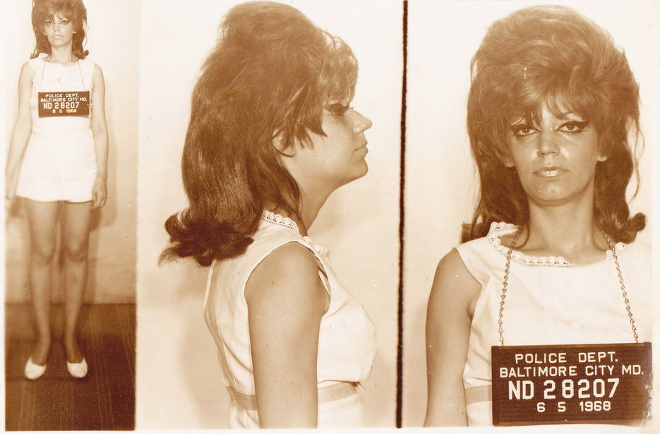 A few vintage mugshots include full-length photos, like this shot from Baltimore in 1968.