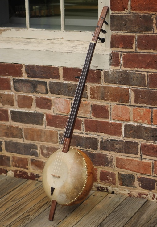 A contemporary gourd banjo by Pete Ross, based on traditional designs used by the Mande people of West Africa.