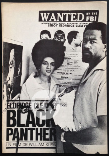 "Kathleen and Eldridge Cleaver with their infant son, Maceo, pose in front of an FBI ""Wanted"" poster on the press book for the 1969 Algerian documentary, ""Eldridge Cleaver, Black Panther."" Eldridge Cleaver had fled to Algeria to avoid murder charges in California. (Via eBay)"