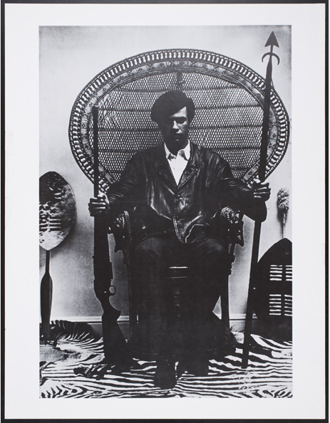 Eldridge Cleaver composed this famous 1966 image of Huey Newton, shot by Blair Stapp. Newton holds a spear and a gun while surrounded by Africana. (Courtesy of the Oakland Museum of California, All of Us or None Archive)