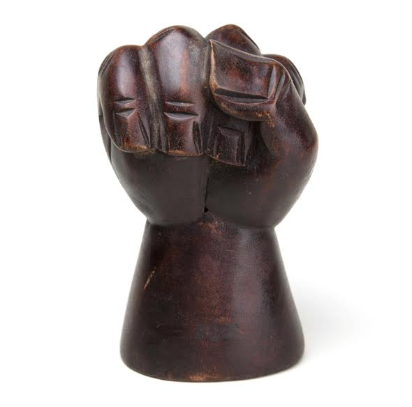 "A wooden ""clenched fist,"" circa 1965, appears in the exhibition, ""All Power to the People: Black Panthers at 50."" (Courtesy of the Oakland Museum of California)"