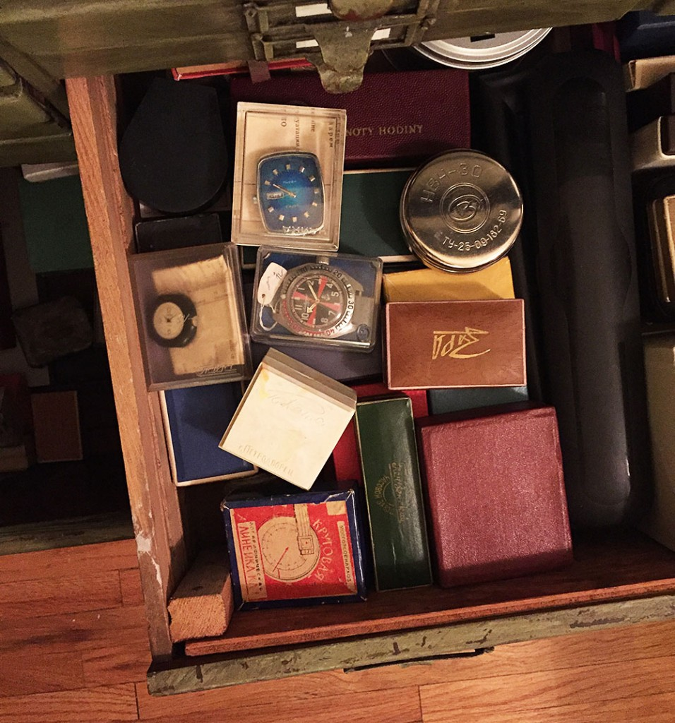 A drawer of new old stock (NOS) pieces in their original boxes, including the first Soviet quartz watch, the Chaika 3050, which has a blue rectangular face.