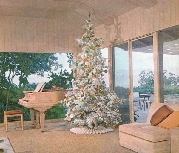"The December 1961 ""House Beautiful"" featured a white Christmas tree in an elegant, beige Modernist room. (From Mid-Century Christmas, reprinted with permission of Hearst Communications, Inc.)"