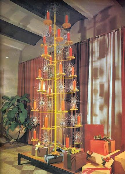 "An ultra-Modern Christmas tree of candle holders and starbursts was shot for the December 1961 issue of ""House Beautiful."" (From Mid-Century Christmas, reprinted with permission of Hearst Communications, Inc.)"