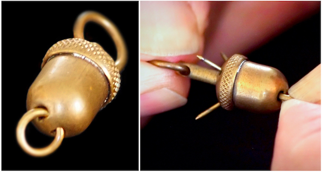The barbs on this acorn-shaped pocket-watch fob were designed to catch on one's clothing to foil would-be thieves.